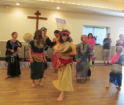 We are so grateful to Sylvia for teaching our youngsters how to dance the Dabke!  At each festival we alternate shows between the adults and the kids.  The young ladies in this photo are having a great time!