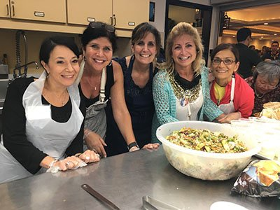 Guests comes from miles away to enjoy the lamb dinner served during the Hafli on Saturday evening. Sonia, Donna, JoEllen, Anne and Mona are excited to work the kitchen for this high energy event.