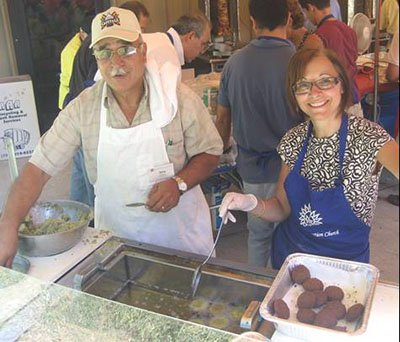 Jerry and Alma fry the falafel, a classic Arabic vegetable burger made with chickpeas, garlic, onions, and spices.