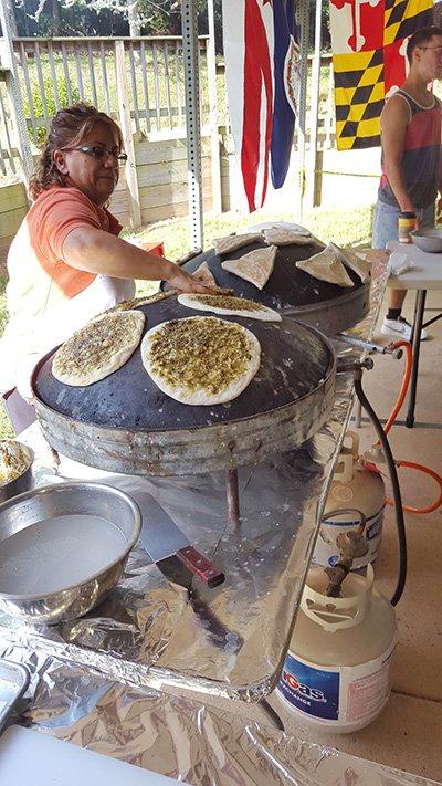 Miro of ZuZu Cuisine prepares zaatar bread. Sumac, a ubiquitous Middle Eastern spice, is a key ingredient in the zaatar blend.