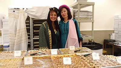 Nikki and Katrina, both outstanding cooks and bakers, pose in front of the extensive sweets table.
