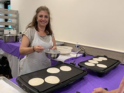 Vivian prepares the Atayef pancakes on the portable griddles.  Soon they'll be stuffed with a delicious pistachio mixture and rose-water simple syrup.