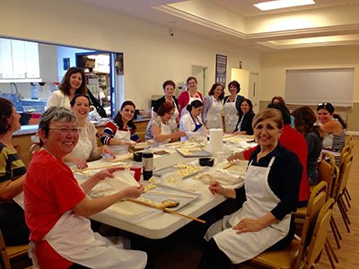 A favorite cookie to make is the Pistachio Bird's Nest Baklawa, which takes a lot of practice!  It requires the use of a dowel to roll the dough tightly in order to shape it into a nest.  We're always grateful to have a large turnout for this activity.